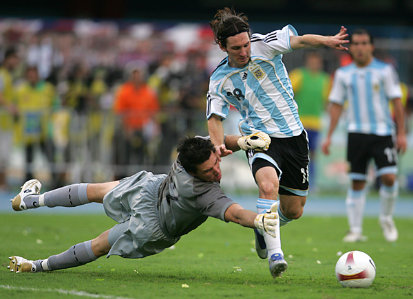 Messi playing soccer