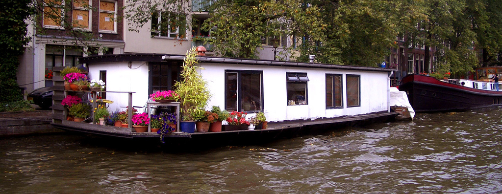 This houseboat in Amsterdam is one of the unique accommodations that you'll find on your travels ... photo by CC user nakedsky on Flickr